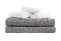 Stack of grey and white bath towels. Isolated over white Stock Photos