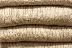 Stack grey woolen knitted sweaters close-up, texture, background royalty free stock photography