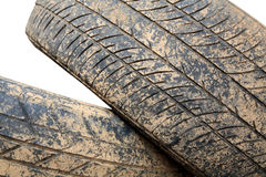 Stack of grunge car tire with brown dirt. Isolated on white Stock Photo