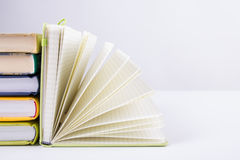 Stack of hadrback books on white background. Library education concept. Back to school. Copy space Stock Photos