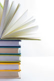 Stack of hadrback books on white background. Library education concept. Back to school. Copy space Royalty Free Stock Photo