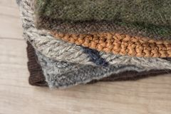 Stack of Hand Knitted Warm Winter Socks Scarfs Mittens From Coarse Wool Yarn Brown Beige Grey. Close up. Eco Fashion Kinfolk. Style. Natural Materials Copy Royalty Free Stock Images