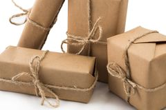 Stack of handcraft gift boxes on white background Stock Photo