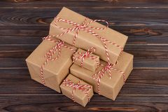 Stack of handcraft gift boxes on wooden board with a natural textured background Royalty Free Stock Image