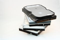 Stack of hard disks. Four 3.5-inch hard disks stacked in a fan pattern Royalty Free Stock Image