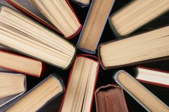 Stack of hardback books. Background. Many colorful books piles, close-up. Education concept Stock Photography
