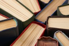Stack of hardback books. Background. Many colorful books piles, close-up. Education concept Royalty Free Stock Photography