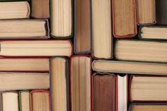 Stack of hardback books. Background. Many colorful books piles, close-up. Education concept Royalty Free Stock Images