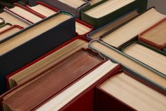 Stack of hardback books. Background. Many colorful books piles, close-up. Education concept Stock Photos