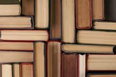Stack of hardback books. Background. Many colorful books piles, close-up. Education concept Stock Images