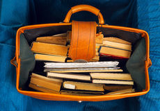 Stack of hardback books in an old suitcase with. Stack of hardback books in an old suitcase with a retro effect. Back to school. Copy space. Top view Stock Photo