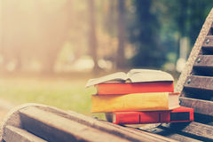 Stack of hardback books and Open book lying on Stock Photo