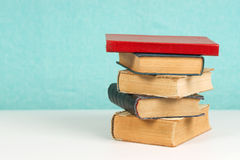 Stack of hardback books on table. Back to school. Copy space stock photos