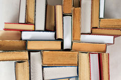 Stack of hardback books on table. Top view. Stack of hardback books on table. Back to school. Copy space. Top view stock images