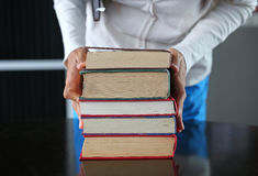 Stack of hardback books in woman hands. Education background royalty free stock photos