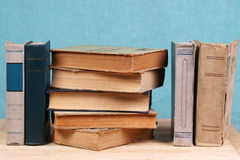 Stack of hardback books on wooden table. Back to school. Copy space Stock Photos