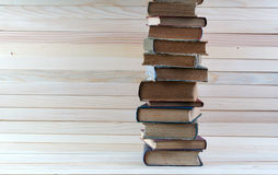 Stack of hardback books on wooden table. Back to school. Royalty Free Stock Image