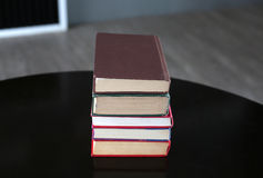 Stack of hardback books on wooden table. Education background stock photos