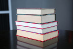 Stack of hardback books on wooden table. Education background royalty free stock photos