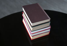 Stack of hardback books on wooden table. Education background royalty free stock image