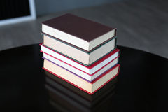 Stack of hardback books on wooden table. Education background royalty free stock images
