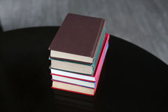 Stack of hardback books on wooden table. Education background stock image