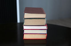Stack of hardback books on wooden table. Education background royalty free stock photo