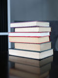 Stack of hardback books on wooden table. Education background stock images