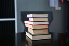 Stack of hardback books on wooden table. Education background stock photo
