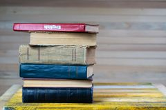 Stack of hardback books on wooden table. English textbook. royalty free stock photos