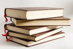 Stack of hardbound books. A close up view of a stack of several hardbound books.  White background Stock Images