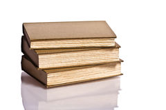 Stack of hardcover books with reflection. Hardcover books reflection white background Royalty Free Stock Image