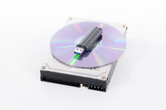 Stack of harddrive, compact disc and USB stick on white backgrou Stock Photo