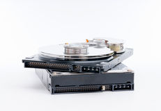 Stack of harddrives on white background Royalty Free Stock Photography