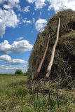 Stack of hay and pair of pitchfork Stock Images