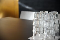 Stack of highballs. Clean drinking glasses stacked on a black table in a cafe stock photos