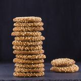 Stack of home made cookies - oat cookies with sesame seeds on the background of black slate Stock Image