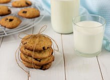Stack of homemade cookies with chocolate pieces and milk. royalty free stock photos