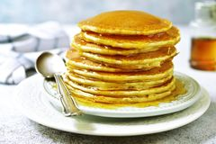 Stack of homemade delicious pancakes with maple syrup for a breakfast. Stack of homemade delicious pancakes with maple syrup for a breakfast on a plate on a royalty free stock photography