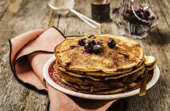 Stack of homemade freshly baked pancakes crepes with black currant berries Royalty Free Stock Photo