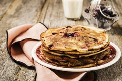 Stack of homemade freshly baked pancakes crepes with black currant berries Stock Photos