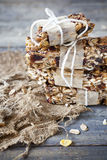 Stack of homemade granola bars with dried fruits and handmade packaged Royalty Free Stock Photo