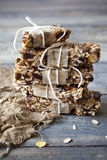 Stack of homemade granola bars with dried fruits and handmade packaged Royalty Free Stock Image