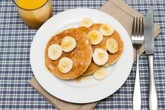 Stack of homemade pancakes with banana Stock Photo