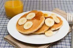 Stack of homemade pancakes with banana Stock Photos