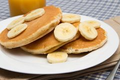 Stack of homemade pancakes with banana Royalty Free Stock Images