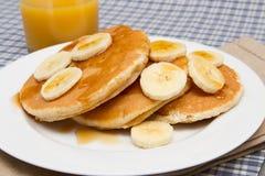 Stack of homemade pancakes with banana Royalty Free Stock Photos