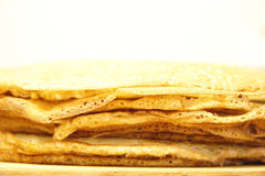 Stack of homemade pancakes on wood cooking board Stock Photos