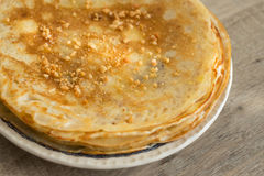 Stack of homemade wheat pancakes with honey Stock Photo