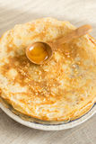 Stack of homemade wheat pancakes with honey Royalty Free Stock Photography